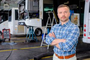 71546280 - portrait of man in bus depot